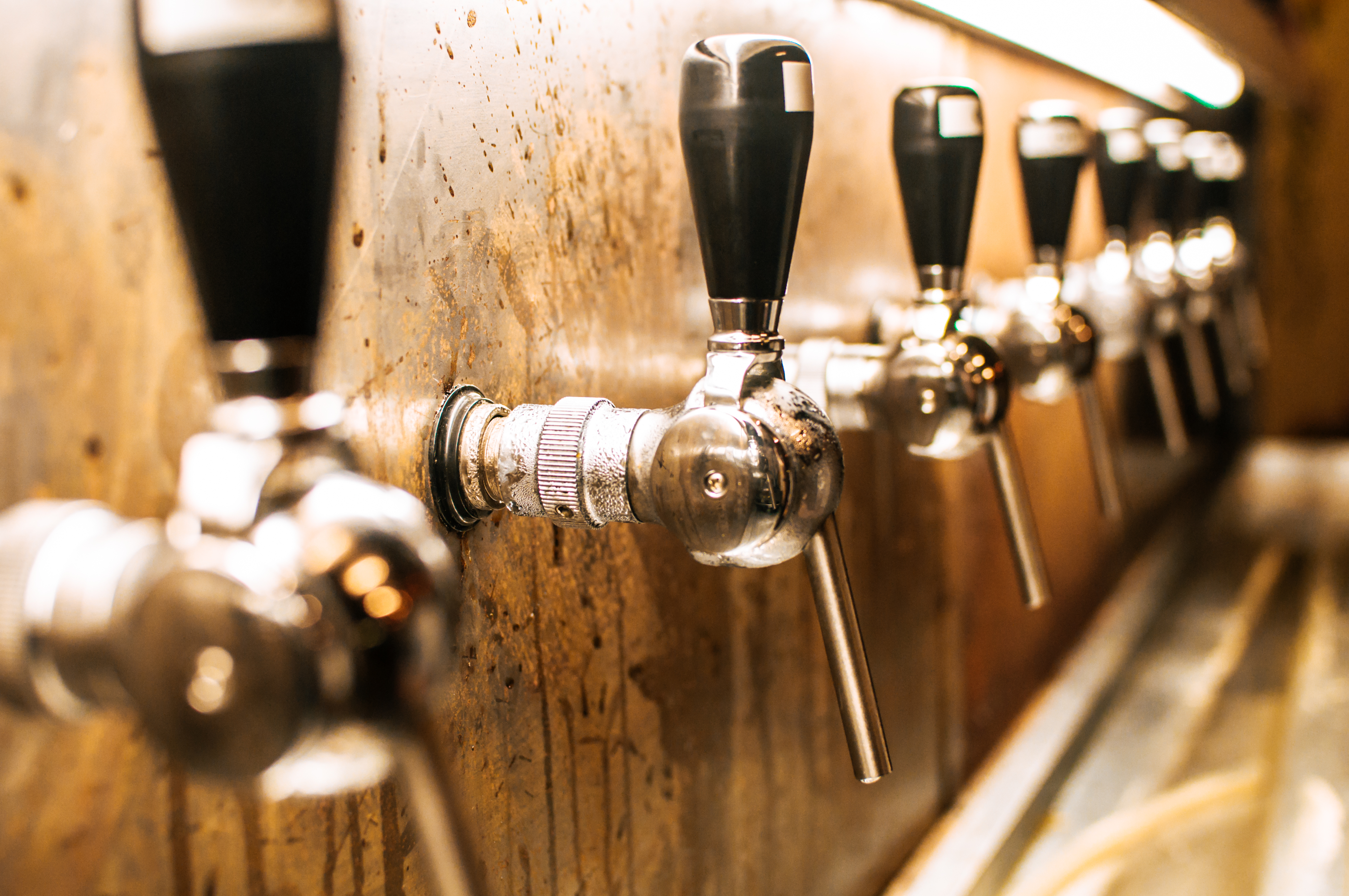 Beer taps in brewery